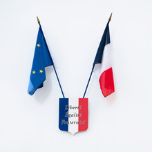 """French And European Flag Above A Coat Of Arms In The Colours Of France On Which It Is Written: """"equality, Freedom, Fraternity"""" At The Entrance Of A School"""