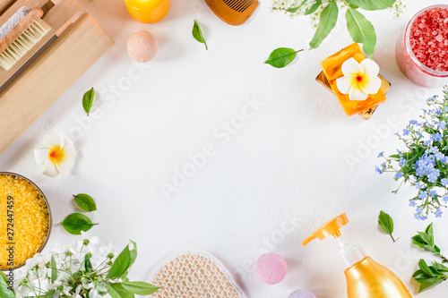 Fototapety, obrazy: Spa and bath accessories with bath salts and beauty treatment products on white table. Wellness concept