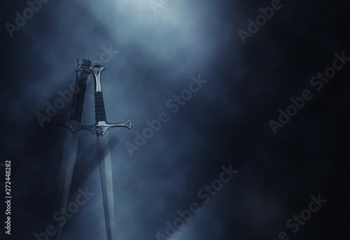 mysterious and magical photo of silver sword over gothic black background with smoke Wallpaper Mural