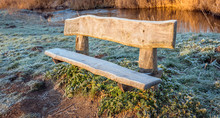 Rough Wooden Bench In The Earl...