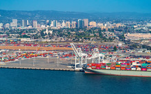Oakland Harbor Port Terminal With Cargo Ship And Shipping Containers