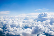Leinwandbild Motiv White clouds on blue sky background close up, cumulus clouds high in azure skies, beautiful aerial cloudscape view from above, sunny heaven landscape, bright cloudy sky view from airplane, copy space