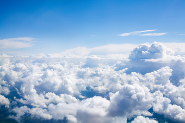White clouds on blue sky background close up, cumulus clouds high in azure skies, beautiful aerial cloudscape view from above, sunny heaven landscape, bright cloudy sky view from airplane, copy space
