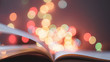 Leinwanddruck Bild - the book page on colorful light blurred bokeh for education, reading, knowledge, fiction, fairy concept background