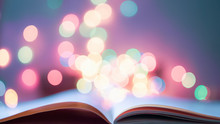 The Book Page On Colorful Light Blurred Bokeh For Education, Reading, Knowledge, Fiction, Fairy Concept Background