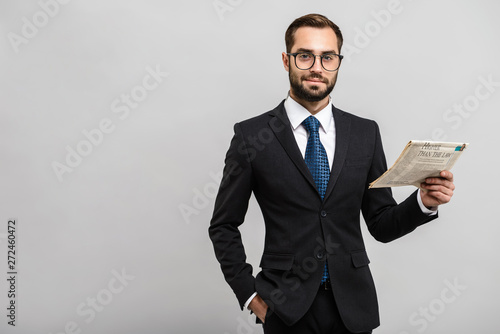 Obraz na płótnie Handsome confident businessman wearing suit standing
