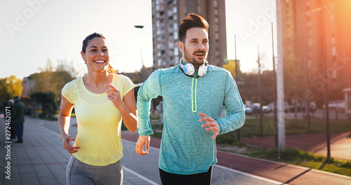 In de dag Eigen foto Young fitness couple running in urban area