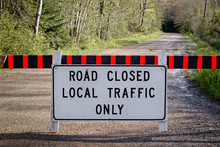 Road Closed Sign On Rural Dirt Road.