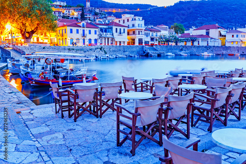 Foto auf Leinwand Dunkelblau Greece, Europe - scenic twilight scenery of street cafe in ancient Greek harbor Nafpaktos. Nafpaktos was important part of ancient Greece. Nowdays Nafpaktos is popular travel destination in Greece.
