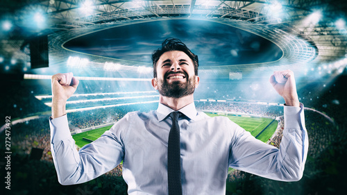 Photo Man who rejoices at the stadium for winning a rich soccer bet