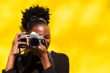 African Woman With Camera In Her Hands Close Up