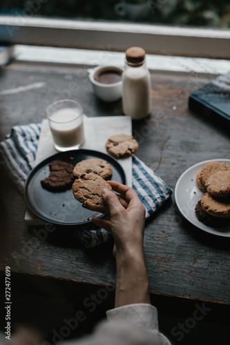 Cookies with Milk on dark wood table