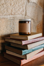 Candle Sitting On Top Of Vintage Books