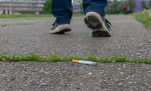 An Abandoned Smoking Cigarette...