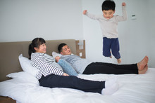 Happy Asian Family Of Four In Home