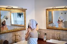 Girl Taking Beauty Care In Bathroom