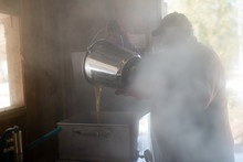 Maple Syrup Farmer Processes Fresh Natural Syrup In Steamy Sugar Shack