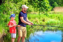 Family Fishing. Father And Son On Fishing. Parent And Child On Riverside Catching Fish
