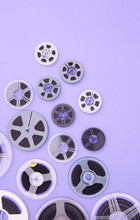 Film Reels Over Mauve Background
