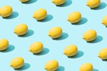 Trendy Sunlight Summer Pattern Made With Yellow Lemon On Bright Light Blue Background. Minimal Summer Concept.