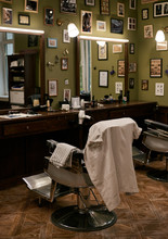 Chair Of Stylish Barbershop In Interior