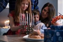 Hanukkah: Family Lighting Menorah For Holiday