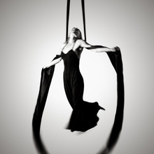 Woman Hanging From Silks
