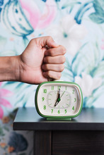 Man Hitting A Retro Alarm Clock
