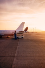 Commercial Airplane At Sunrise