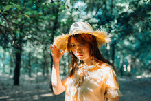 Portrait Of Asian Woman In Forest With Dramatic Light