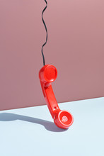 Red Telephone Receiver Hanging.