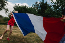 Little Boys Running With A French Flag Before World Cup Soccer / Football Game.