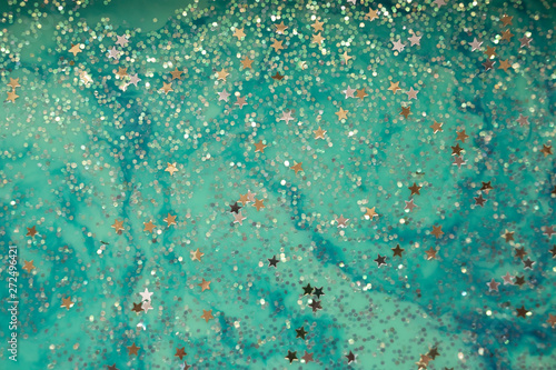 Ice Cold Sea of Stars Enchanting cool blues lazily swirl around stars and sparkles. Dreamy and magical. Unique fantasy background and texture.