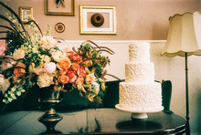 Beautiful Flower Bouquet And Wedding Cake In Retro Living Room