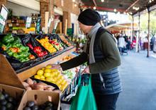 Man Food Shopping At A Market