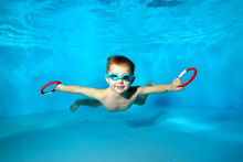 Sporty Little Boy Swimming Und...