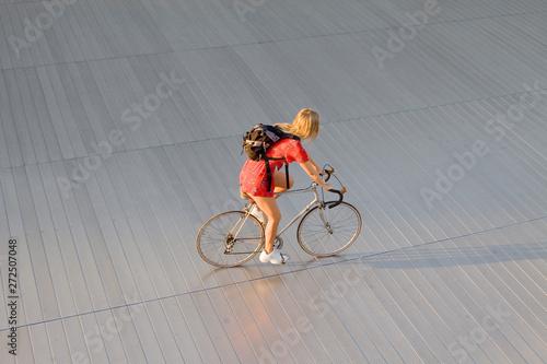 young woman on racing bike