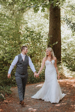 Happy Couple Walking On Forest...