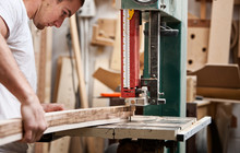Woodworking: Man Uses Jig Saw To Cut Trim Piece