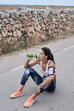 Runner Resting And Drinking Wa...