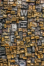 Dusty Old Metal Letterpress Type Pieces Background