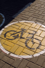 Bicycle Path Sign On Pavement
