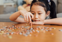 Little Girl Counting Coins