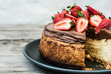 Cheesecake With Chocolate And Strawberry Topping