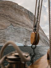 Old Vintage Sailing Vessel And Icebergs Floating In The Arctic Close To Greenland