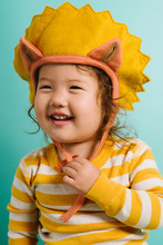 Portrait Of Toddler In Lion Costume