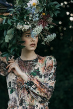 Model In Dress With Floral Hea...