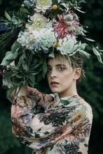 Model In Dress With Floral Headwear