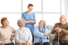 Young Caregiver With Group Of ...