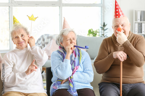 Tableau sur Toile Happy senior people spending time together in nursing home